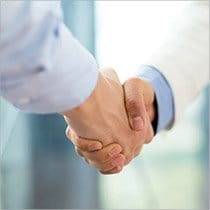 A close up of a handshake