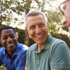 men talking and laughing with dental implants in Dallas