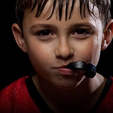 boy with mouthguard in