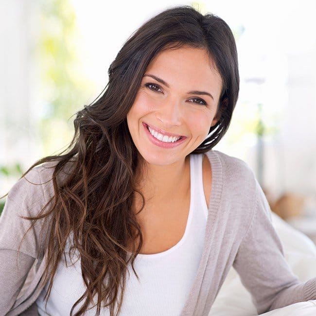 woman smiling brightly