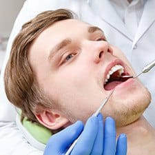 close-up of a man at the dentist