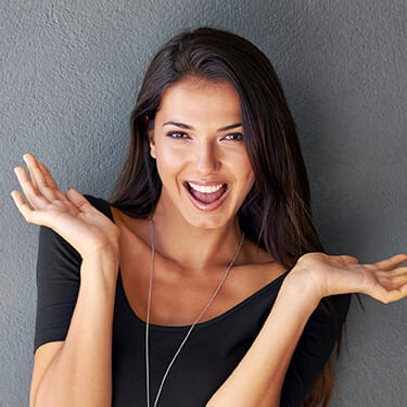 woman excited with hands in air