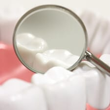row of teeth with mirror