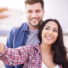 man and women smiling for selfie