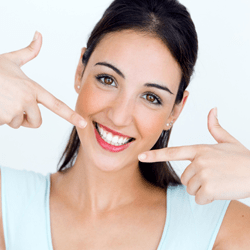 Woman pointing to bright smile